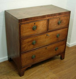 Four drawer George III chest angle right