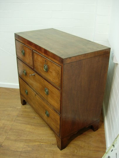 Four drawer George III chest topangle left